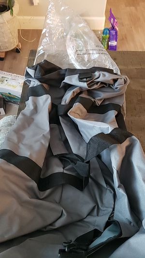 Grey and black duffle bag with wheels, new for Sale in Hesperia, CA