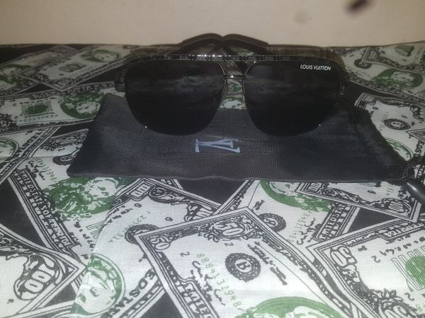 Gucci and Louis Vuitton wallets, glasses