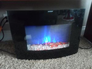 Mainstays Heater and multicolored fire place for Sale in Grants Pass, OR