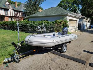 20hp outboard with boat and trailer for Sale in Chicago, IL