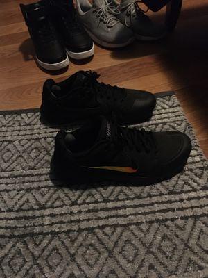 Black nike rubber shoes for Sale in Douglasville, GA