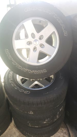Jeep Wrangler Unlimited Sahara wheels and tires and spare! for Sale in Miami Gardens, FL