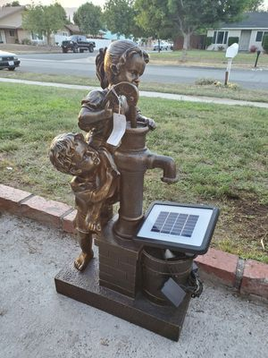 Brand new resin team work water fountain solar pump or power pump 30 inches tall for Sale in Fontana, CA