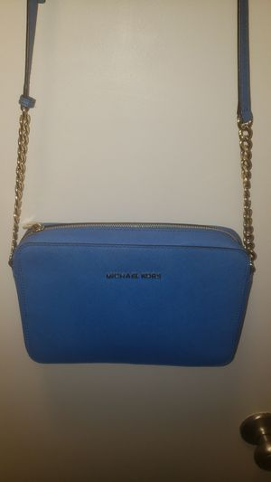 Michael Kors small blue purse with adjustable strap for Sale in Seattle, WA