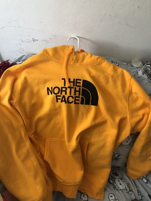 The north face yellow hoodie Size XL for Sale in Norwalk, CA