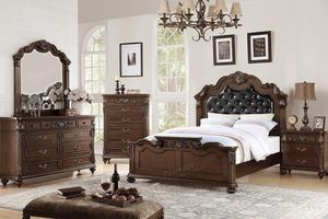 $1,699 Fit for a queen, this queen bed frame dresser mirror and one night stand/With Mattress features carved floral accents on the headboard and foo for Sale in Chino, CA