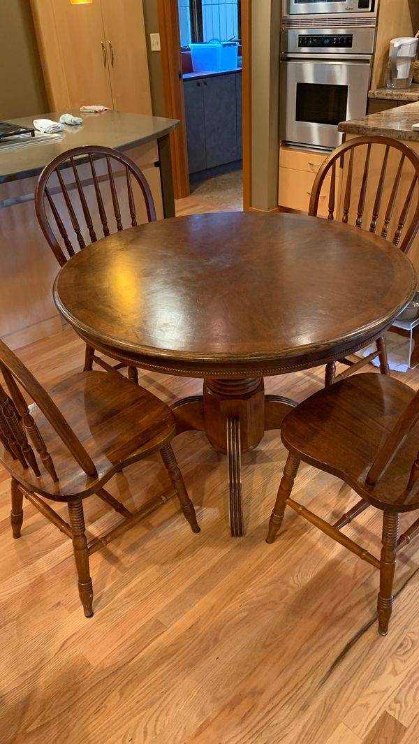 "Wooden round kitchen table, 42"" diameter 29"" height with 4 chairs"