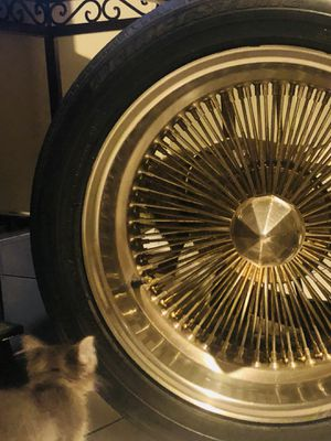 Low rider rims gold tainted HMU $300 includes 4 rims and tires for Sale in Los Angeles, CA