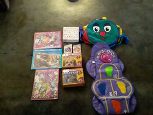 6 puzzles, 2 card games,Caterpillar tunnel,hopscotch mat for Sale in Fresno, CA