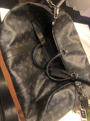 Louis Vuitton Black Duffle Bag mint condition for Sale in Chicago, IL
