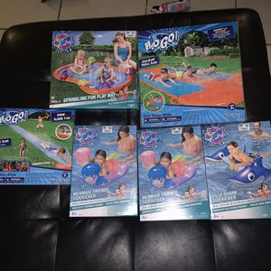 Kids summer toys and water for Sale in Daytona Beach, FL