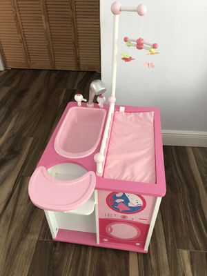 Babydoll changing table, high chair, bath and storage. for Sale in Fort Lauderdale, FL