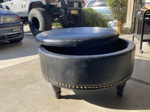 Round black leather ottoman/coffee table with storage for Sale in La Quinta, CA