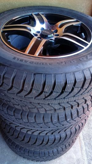 215/70R16 wheels/snow tires almost new 5holes universal 5x114 minivan, CRV, element, rav4 for Sale in Vancouver, WA