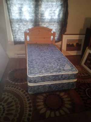 Twin size bed complete! Headboard, metal frame and super nice and clean mattress. No stains! Perfect for the person just starting out! for Sale in High Point, NC