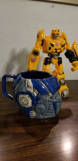 Bumble Bee toy and Optimus Prime ceramic mug- Universal Studios 2012 collectable for Sale in Surprise, AZ