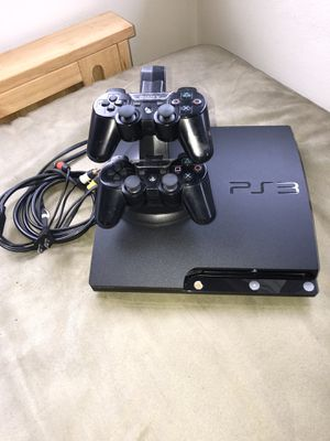 Sony Play Station P3 w/2 controllers, stand & Cables for Sale in Seattle, WA