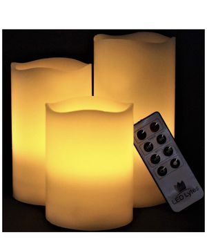 LED Lytes Flameless Candles Set of 3 Ivory Wax Flickering Amber Yellow Flame, Auto-Off Timer Remote Control Fake Battery Operated Candles New in the for Sale in Hoover, AL