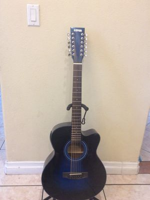 Fever 12 string electric acoustic guitar with built in tuner with soft case strap and cable for Sale in South Gate, CA