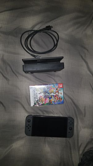 Nintendo switch comes with 2 games skyrim and smash brothers for Sale in Tampa, FL