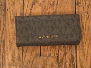 Brand new Michael Kors wallet never used originally cost $178. Asking price is $60 for Sale in Mount Rainier, MD