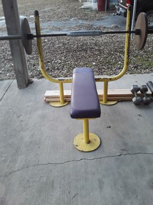 4, 45 lb plates 2, 30 lb dumbbells 2, 25 lb plates 4, 5 lb plates 7, 2.5 lb plates With weight bench, Olympic barbell and rack for Sale in Farmersville, TX