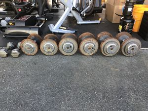 Dumbbells 20s 30s 55s Pro dumbbells have ergo grip Hex 10s not included 210 pounds total for $105 .50 cents only per pound for Sale in Federal Way, WA