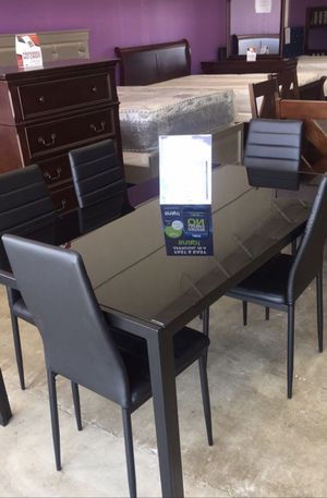 Furniture table with six El Rio furniture finance available down payment $39 1456 belt line rd suite 121 Garland tx 75044 Open from 9:30-8:30 for Sale in Richardson, TX