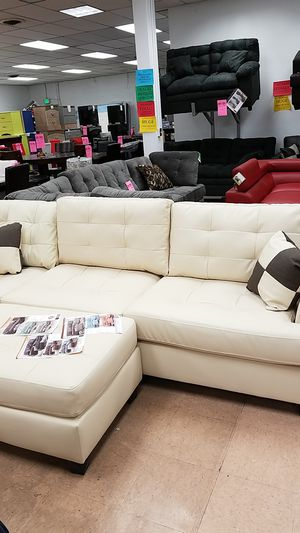 Cream beige leather sectional sofa couch with ottoman and 2 matching throw pillows for Sale in Baltimore, MD