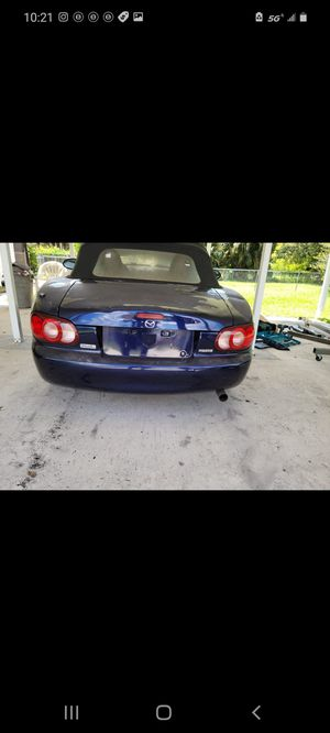 2003 Mazda miata soft top and part out. Tail lights. Trunk lid. Rear bumper. Driver side door etc for Sale in Fort Lauderdale, FL