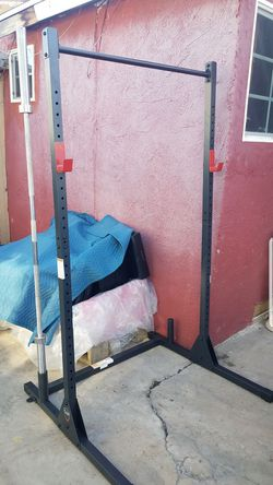 7 foot 45lbs Olympic barbell with a 7 foot squat rack NEW for Sale in Los Angeles,  CA