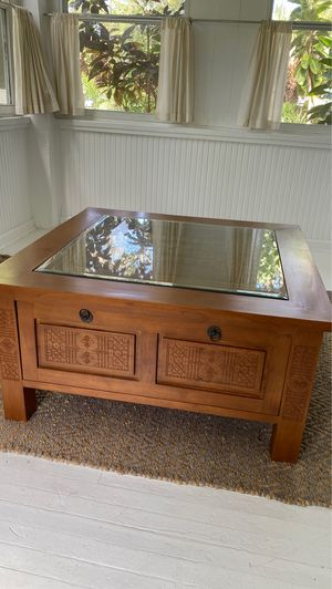 Beautiful wood carved coffee table with glass top for Sale in St. Petersburg, FL