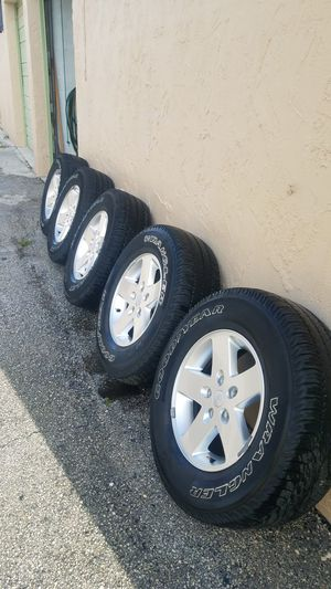 Jeep wrangler 5 wheels and tires aluminum oem for Sale in North Miami Beach, FL