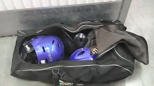 Softball helmets and Duffle bag for Sale in Chandler, AZ