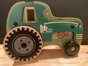 FUN FARM WOODEN TRACTOR / - BY MIGHTY DRIVERS - TRACTOR IS 8 1/2INCHES 2 INCHES THICK ! IT IS SOLID HEAVY WOOD!!! for Sale in Modesto, CA