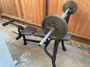Weight bench with barbell and 2 25 lb cast iron plates for Sale in Stockton, CA