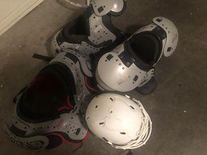 3 Shoulder Pads and 1 Helment for Sale in Phoenix, AZ