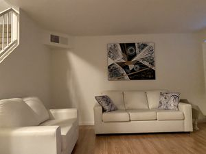 White leather living room set + wall art +.decorative pillows for Sale in Las Vegas, NV