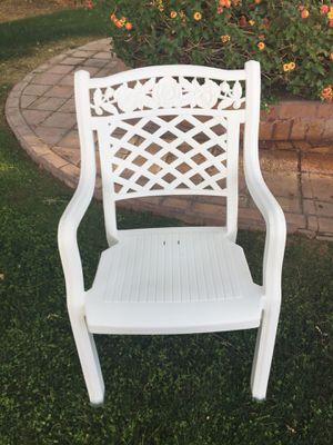 Four matching fanciful resin stackable patio chairs. Perfect for a wedding SEE MY OTHER OFFERS for Sale in Scottsdale, AZ