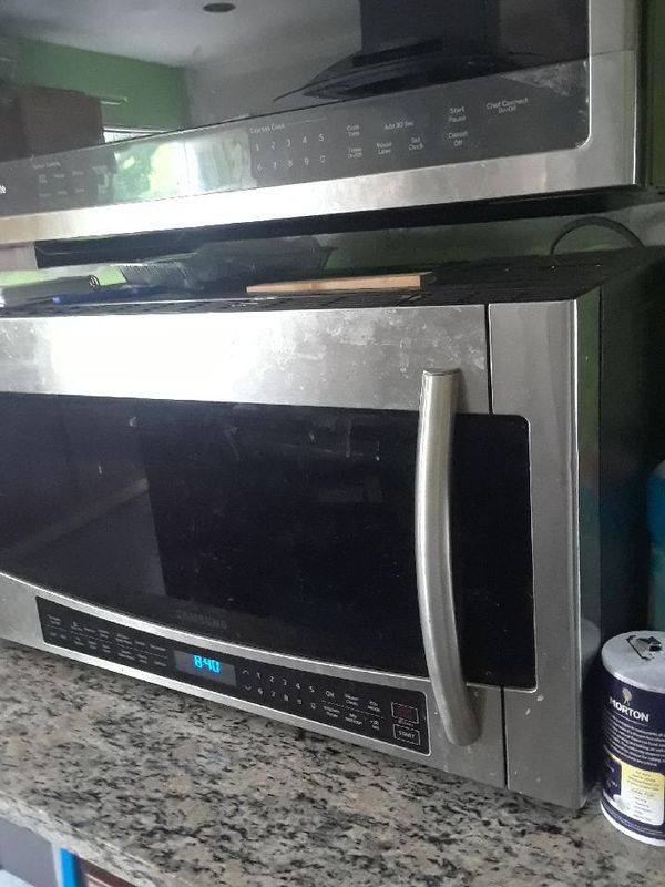 Various commercial kitchen appliances. Glass door freezer, commercial microwave oven, and oven