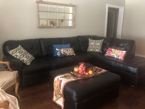 Black leather sectional sofa and ottoman for Sale in Hollywood, FL