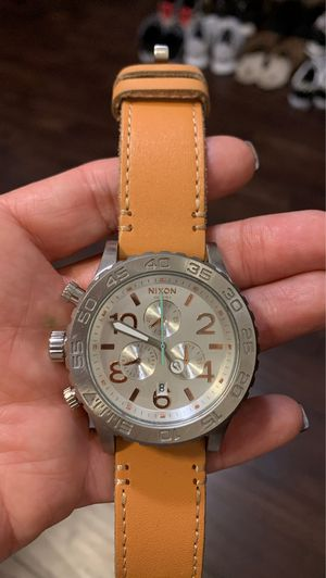Light Brown leather Nixon watch the stainless steel face. for Sale in Chandler, AZ