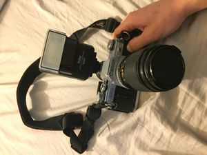 (Classic Film Camera) Canon AT-1 with 135mm lens, flash and bag for Sale in North Las Vegas, NV