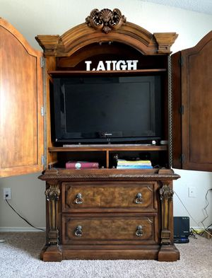 Beautiful solid wooden armoire for Sale in Orlando, FL