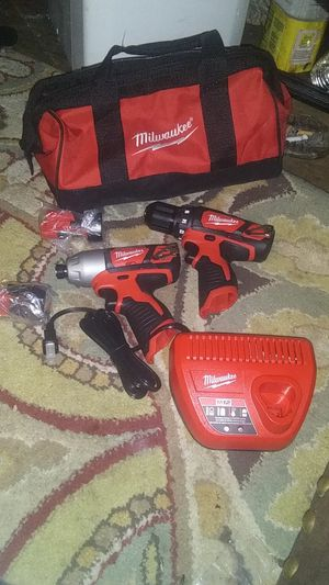 Milwaukee M12 3/8 hammer drill / driver and 1/4 driver with two batteries and charger brand new never been used for Sale in Oklahoma City, OK