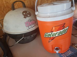 COORS PORTABLE CHARCOAL GRILL AND WATER COOLER for Sale in Phoenix, AZ