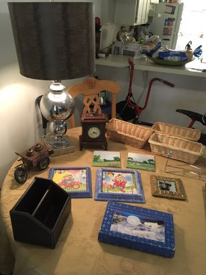 Evrything for $50 on the table big chrome lamp clown painted with frames tiles painted antique clock with storage door and antique ice cream tricycl for Sale in Doral, FL