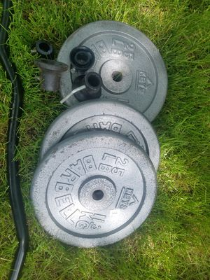 Curl Bar with Four 25lb Steel plates for Sale in Glen Ellyn, IL
