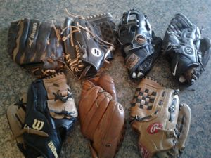 Mix lot of base ball gloves for Sale in Phoenix, AZ