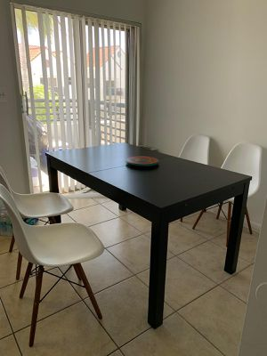 Dining set with 4 designer chairs. for Sale in Dania Beach, FL